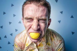 man eating lemon
